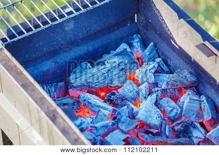 Barbecue Charcoals With Red Glow And Fire