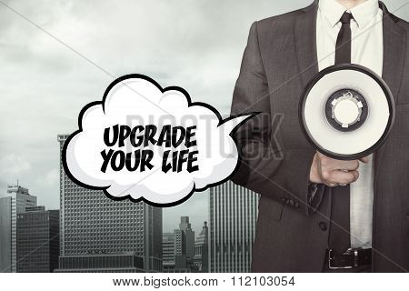 Upgrade your life text on speech bubble with businessman and megaphone