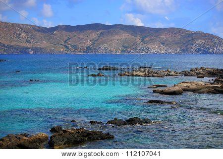 Blue lagoon. Sea coast. Stone reef.