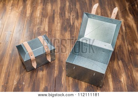 Two Metal Tool Box On Wooden Table