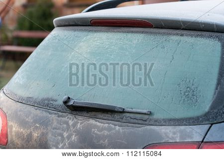 car covered with frost. very cold morning