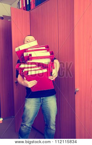 Man Carrying Folders With Documents