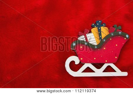 Red Plush Fur And A Santa Sleigh With Presents Christmas Background