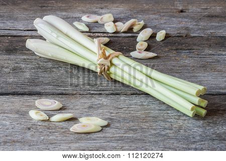 Lemongrass slice on wooden background.