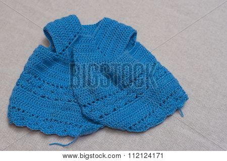 blue dress made of wool to crochet rag dolls.