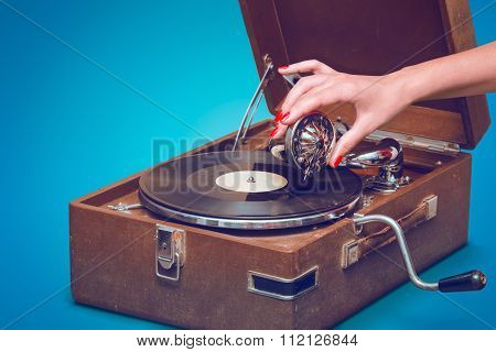 Old Portable Gramophone With Female Hand