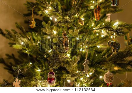 Christmas Tree With Beautiful Lights, Decoration And Toys Close-up At Home