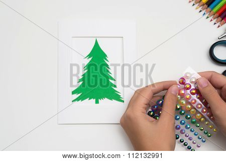 Girl Is Making Christmas Card