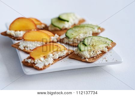 Fresh ricotta cottage cheese snack starter platter appetiser with sliced peach nectarine and cucumber, perfect party canapes