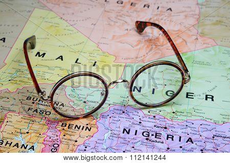 Glasses on a map - Niamey