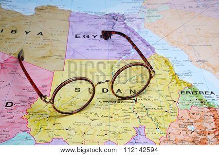 Glasses on a map - Sudan