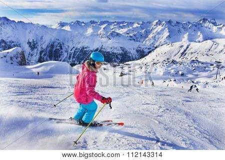 Girl skier in winter resort