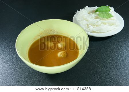 Fish Curry Sauce And Vermicelli On Black Background
