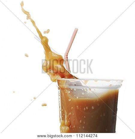 Cup of ice coffee with splashes, isolated on white