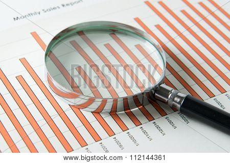 Magnifying Glass Over Sales Report