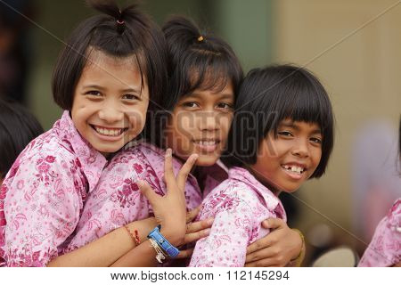 SATUN, THAILAND, DECEMBER 09, 2011 : Portrait of three Thai little girls in a social school orphanage in Satun, Thailand.
