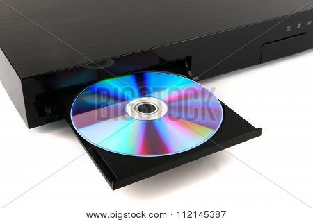 DVD, CD disk insert to dvd player on white background, close-up, isolated