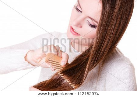 Woman Combing And Pulls Hair.