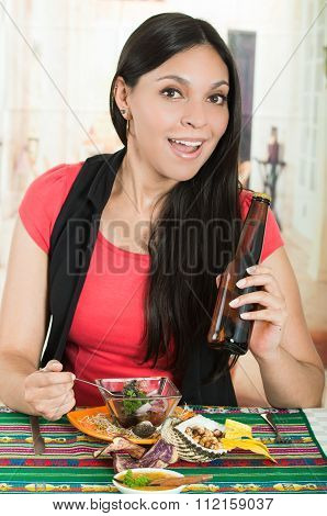 Beautiful young brunette girl enjoying a seafood cebiche