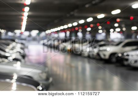 Blurred Car Parking With Bokeh Light Background