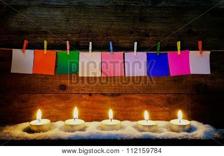 Candles Flame With Papernote On Wooden  For Christmas Decoration