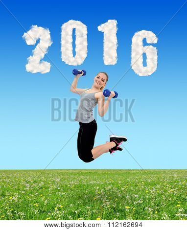 Happy healthy active girl jumps with dumbbells. Healthy resolutions for the New Year 2016.