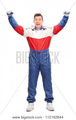 Full length portrait of an overjoyed car racer gesturing happiness isolated on white background