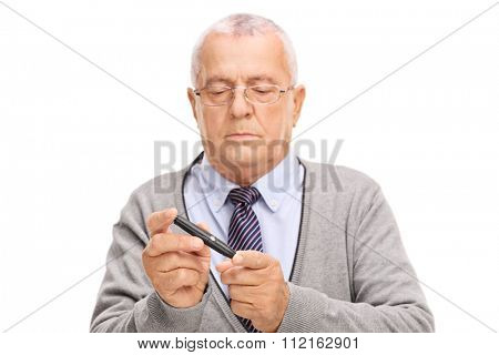 Senior gentleman measuring his blood sugar level with glucometer isolated on white background