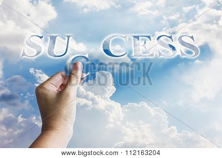 Business Concept Successful, Hand Fulfill Word Success On Sky Background