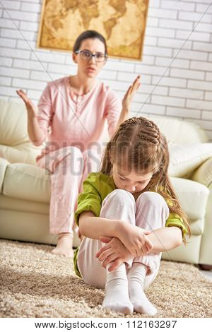mother scolds her child girl.