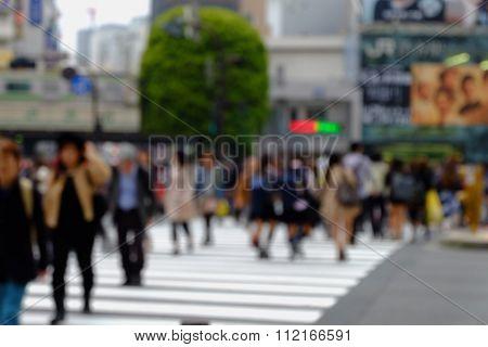 Blurred People In Bokeh. During Crosswalk