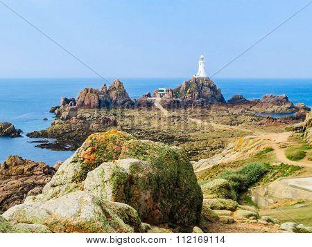 Lighthouse on the rocky coast of Jersey Island