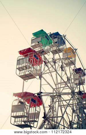 Ferris wheel and sky with retro filter effect (vintage style)
