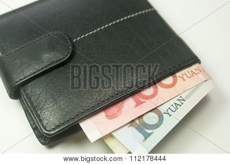 Chinese Yuan Renminbi bank notes inside a wallet