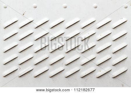 Detail Of Dirty White Panel With Ventilation Grilles