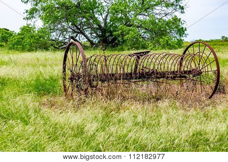 Rusty Old Texas Metal Farm Equipment In Field