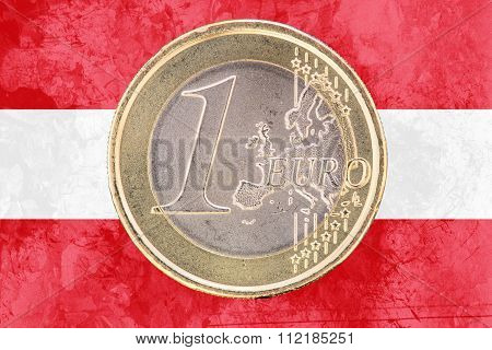 One Euro Coin On The Flag Of Austria As Background