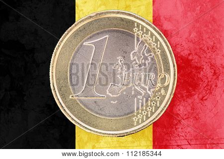 One Euro Coin On The Flag Of Belgium As Background
