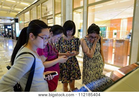SINGAPORE - NOVEMBER 08, 2015: people in The Shoppes at Marina Bay Sands. The Shoppes at Marina Bay Sands is one of Singapore's largest luxury shopping malls