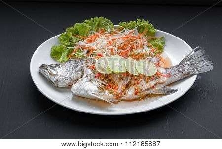 Fish Dish - Steamed Snapper With Lemon On Black Background. Top View
