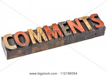 comments word abstract - an isolated banner in vintage letterpress wood type blocks stained by color inks
