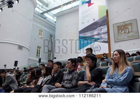ST. PETERSBURG, RUSSIA - DECEMBER 15, 2015: People at the Russian-Chinese Conference on Arts Education during St. Petersburg International Cultural Forum in the Atrium of the General Staff building