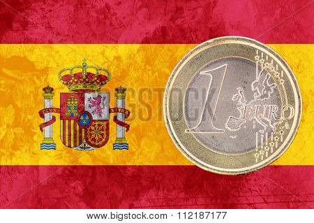 One Euro Coin On The Flag Of Spain As Background