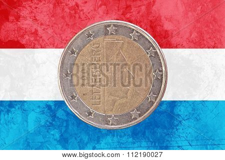 Luxembourgish Two Euros Coin With Flag Of Luxembourg As Background
