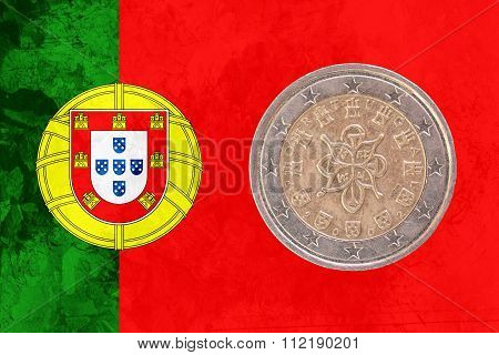 Portuguese Two Euros Coin With Flag Of Portugal As Background