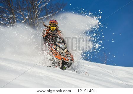 moving snowmobile in winter forest in the mountains of Sakhalin Island