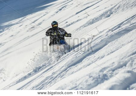 moving Snow Bike Conversion Kit in winter forest in the mountains