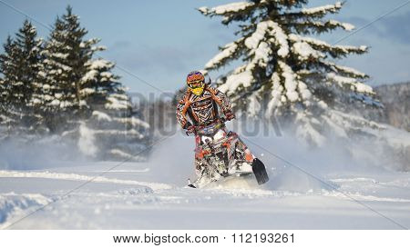 snowmobile in winter forest in the mountains of Sakhalin Island