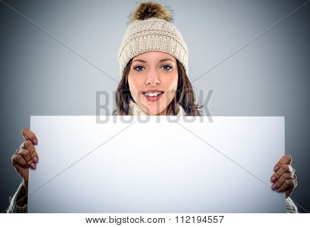 Gorgeous Young Woman Holding A Blank Sign