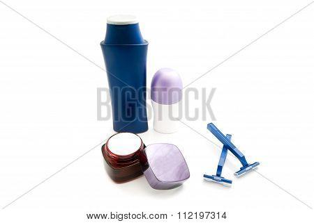 Deodorant, Razors And Shampoo On White